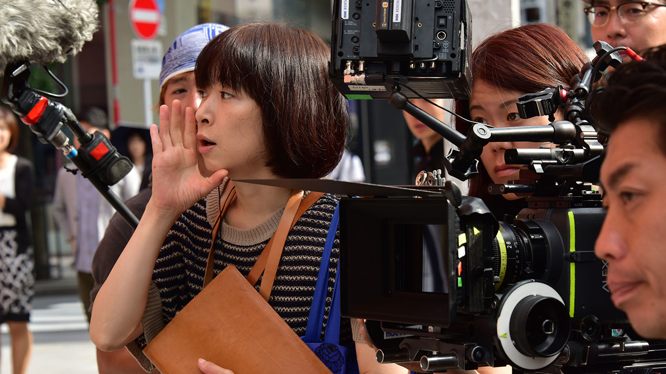 Director Yuki Tanada directing on set.